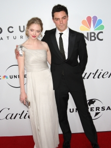 Amanda Seyfried and Dominic Cooper arrive at the NBC, Universal Pictures and Focus Features' official after party for the 66th Annual Golden Globe Awards at the Beverly Hilton Hotel on January 11, 2009
