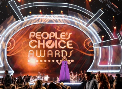 Host Queen Latifah kicks off the show at the 35th Annual People's Choice Awards inside the Shrine Auditorium in Los Angeles
