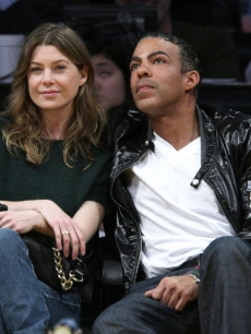 Ellen Pompeo and Chris Ivery attend the Los Angeles Lakers vs. San Antonio Spurs game at the Staples Center