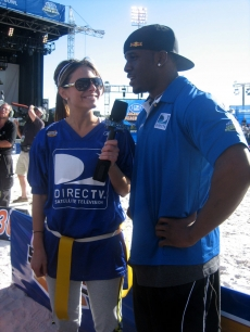 Maria and her coach, Reggie Bush, go over some game details