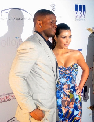 Reggie Bush and Kim Kardashian pose on the red carpet for the Moves Magazine Super Bowl party in Tampa