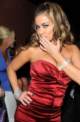 A kiss from Carmen Electra inside the Leather and Laces Super Bowl party
