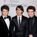 The Jonas Brothers hit the red carpet at the Clive Davis pre-Grammy bash