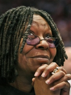 Whoopi Goldberg watches the New York Knicks play the Cleveland Cavaliers at Madison Square Garden