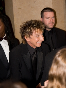 Barry Manilow makes an entrance at the Clive Davis pre-Grammy party