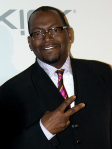 'Idol' judge Randy Jackson flashes a peace sign on the Clive Davis pre-Grammy party red carpet