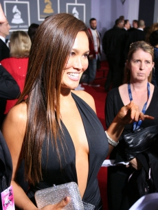 Tia Carrere is interviewed at the Grammys in her dress bought on eBay