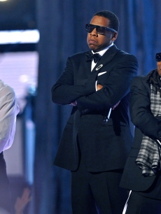 Rappers T.I., Jay-Z, and Lil Wayne perform