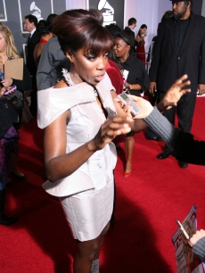 Estelle takes questions from a reporter on the Grammys red carpet