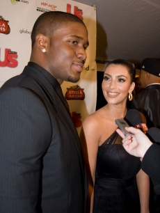 Reggie Bush and girlfriend Kim Kardashian take some questions on the Russell Simmons Grammy afterparty red carpet in LA