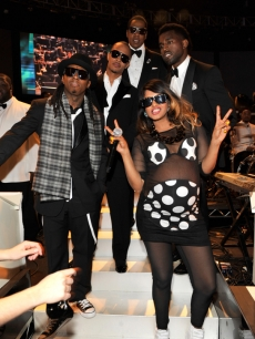 Lil Wayne, T.I., Jay-Z, Kanye West and M.I.A. backstage after their Grammy performance