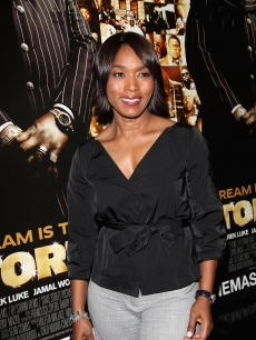 Angela Bassett poses for a photo while attending the 'Notorious' VIP Screening at the Soho Hotel on February 09, 2009 in London, England