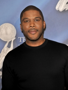 Tyler Perry smiles on the NAACP red carpet