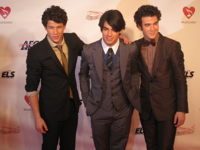 The Jonas Brothers cause a photo frenzy at the MusiCares event honoring Neil Diamond, Los Angeles, Feb. 2009