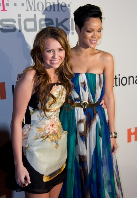 Miley and Rihanna share a red carpet moment at the Clive Davis pre-Grammy bash