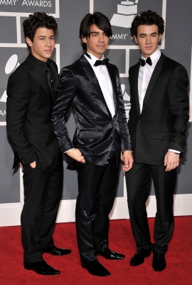 The Jonas Brothers arrive in style on the red carpet