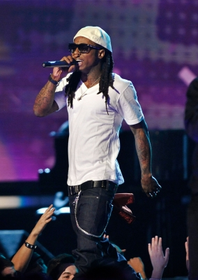 Li'l Wayne performs onstage during the 51st Annual Grammy Awards rocking a white hat