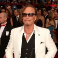 Best Actor nominee Mickey Rourke honors his dog on the Oscars red carpet