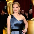 Nominee Kate Winslet glitters on the Oscars red carpet