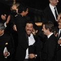 Anil Kapoor celebrates 'Slumdog Millionaire' winning the Best Picture award with producer Christian Colson and actor Madhur Mittal during the 81st Annual Academy Awards held at Kodak Theatre on February 22, 2009 in Los Angeles, California