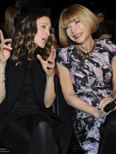 Sarah Jessica Parker, left, and Anna Wintour converse on the runway before the showing of the fall 2009 collection of Alexander Wang during Fashion Week