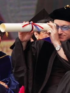 Bono, lead singer and songwriter for the rock group U2 and a social-justice activist, receives an honorary Doctor of Laws degree at the 248th Commencement of the University of Pennsylvania, on May 17, 2004 in Ph