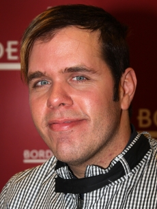 Perez Hilton poses as he signs copies of &#8216;Red Carpet Suicide&#8217; at Borders in Columbus Circle on January 6, 2009 in New York City