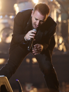 U2 perform at the Brit Awards in London
