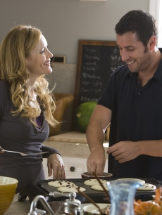 Leslie Mann and Adam Sandler, as a sick comedian, laugh in &#8216;Funny People&#8217;