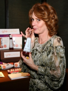 Independent Spirit Best Actress Melissa Leo takes a sip of Glowelle, the ultimate beauty drink, at the Official Gift Lounge backstage