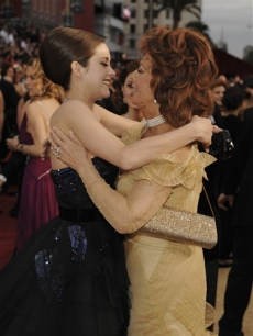 Marion Cotillard and Sophia Loren share a red carpet embrace