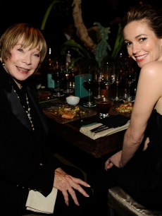 Shirley MacLaine and Diane Lane chat at their table at the Governor's Ball