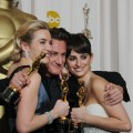 Best Actor winner Sean Penn grabs fellow Oscar winners Kate Winslet (Best Actress) and Penelope Cruz (Best Supporting Actress) backstage at the Oscars