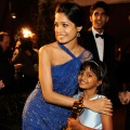 Freida Pinto, Rubiana Ali (holding one of the Academy Award statues that 'Slumdog Millionaire' won) and Dev Patel at the 81st Annual Academy Awards Governor's Ball