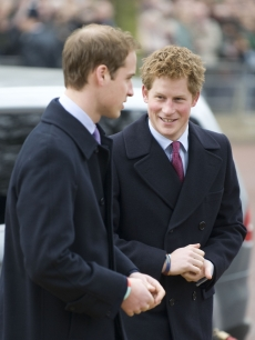 Prince William and Prince Harry attend the unveiling of a statue and bronze reliefs of Queen Elizabeth, the Queen Mother, on the Mall