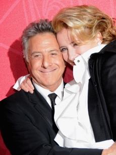 Dustin Hoffman and Emma Thompson share a hug at the Cesar Film Awards in Paris, Feb. 27, 2009