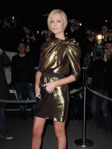 In a gold dress, Charlize theron attends 'The Burning Plain' Paris premiere, March 2, 2009