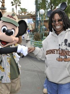 Whoopi Goldberg is greeted by Mickey Mouse at the Disneyland Resort