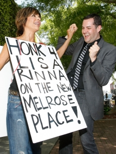 Lisa Rinna (L) and Ross Matthews campaign to get Lisa on 'Melrose Place' on the corner of Melrose Ave and Melrose Place on March 18, 2009 in Los Angeles