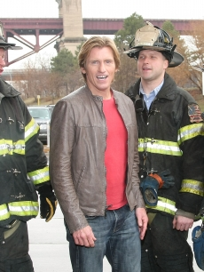 Denis Leary poses with FDNY Firefighters during the dedication and demonstration of The Leary Firefighters Foundation's high-rise training simulator at FDNY Training Academy