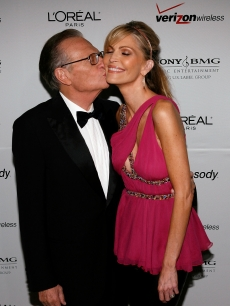 Larry King kisses wife Shawn Southwick-King as they arrive at the Clive Davis pre-Grammy party held at the Beverly Hilton on February 10, 2007 in Beverly Hills, California