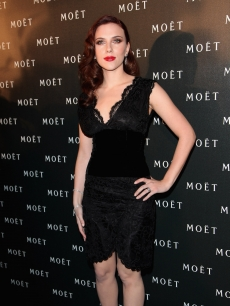 Scarlett Johansson arrives for the Moet and Chandon: A Tribute to Cinema party at Big Sky Studios on March 24, 2009 in London, England