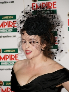 Helena Bonham Carter poses with her best actress award in the press room at The Jameson Empire Magazine Awards