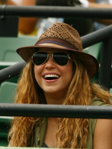 Shakira watches as Rafael Nadal of Spain plays Frederico Gil of Portugal during day 8 of the Sony Ericsson Open, Florida, March 30, 2009