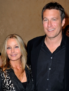 Bo Derek and John Corbett pose during the cocktail reception at the 30th anniversary Carousel of Hope Ball, October 2008