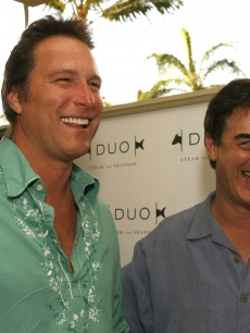 John Corbett and Chris Noth share a laugh at the grand opening of a hotel in Maui, April 28, 2007