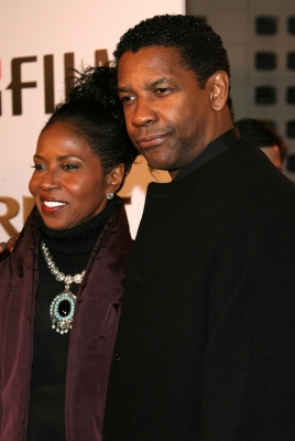 Pauletta Washington (L) and her husband actor Denzel Washington arrive at the MGM premiere of 'The Great Debaters' held at the Arclight Cinerama Dome on December 11, 2007