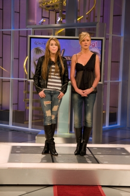 Miley Cyrus and Nancy O'Dell say hello on Access Hollywood