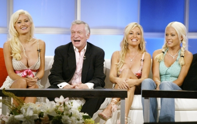 Hugh Hefner and his Playmates, Kendra Wilkinson, Bridget Marquardt and Holly Madison attend the panel discussion for 'The Girls Next Door'