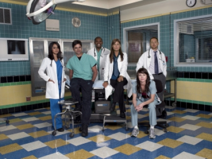 Mekhi Phifer as Dr. Gregory Pratt with other ER cast members